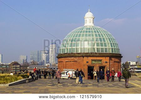 LONDON, UNITED KINGDOM - MARCH 11 2016: People in front of the tunnel entrance on the 11th of March 2016 in Greenwich, London.