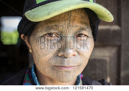 Chin tribe tattooed faced woman (Yin Duu).