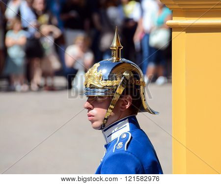 Stockholm, Sweden - May 26, 2014: A guard watches over the Changing of the Royal Guard at the Royal Palace