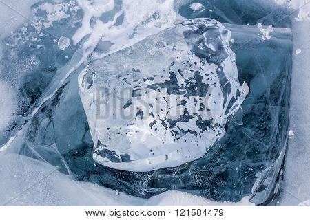 A Transparent Piece Of Ice On The Blue Frozen Lake Baikal.