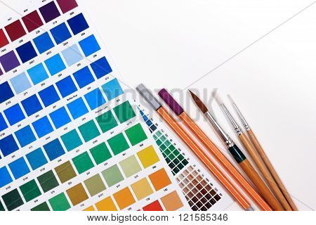 Color Chart Guide To Creative Color Combinations With Brushes On A White Background.