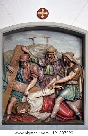 OBERSTAUFEN, GERMANY - OCTOBER 20: Jesus falls the third time, 9th Stations of the Cross, the parish church of St. Peter and Paul in Oberstaufen, Germany on October 20, 2014.
