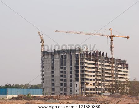 Building construction with Crane at construction site