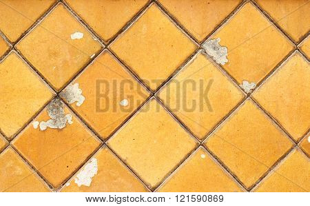 Old Yellow tiles wall textured background for construction