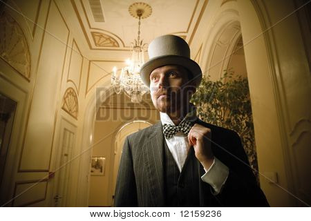 Portrait of a gentleman standing in a hall of a luxury hotel
