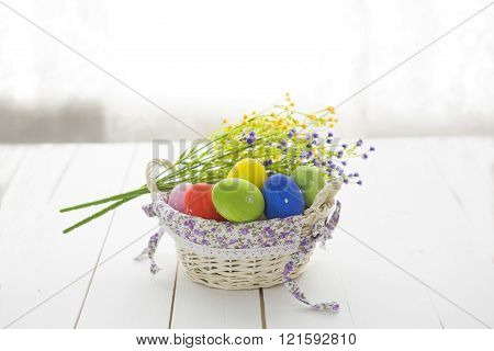 Easter Background With Easter Eggs  And Wildflowers.