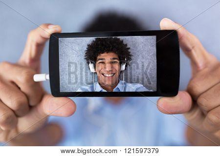 African American man taking selfie