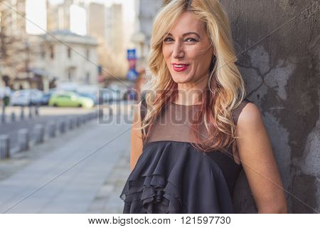 Beautiful young blonde woman in the city