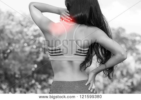 Young Fit Woman in sport bra having neck pain (In Black and White Tone with Red Mark)