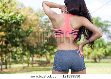 Young Fit Woman in sport bra having neck pain