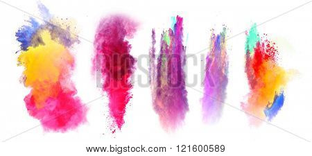 Explosions of colored powder on white background