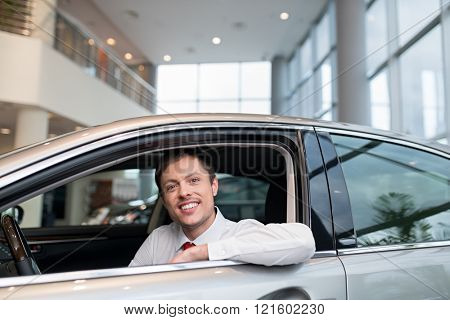 Young attractive seller in car