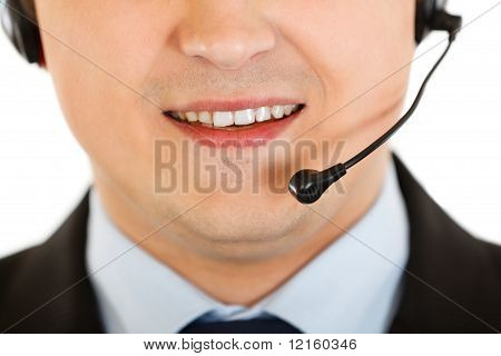 Smiling modern businessman with headset isolated on white. Close-up.