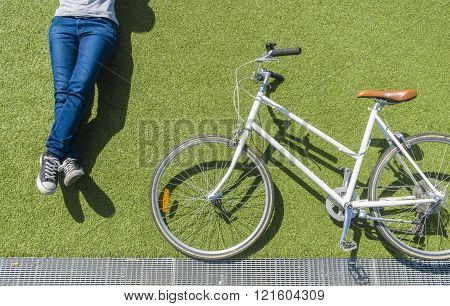 Vintage bike and cyclist on lawn