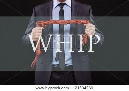 man in business suit with chained hands. handcuffs for sex games. concept of erotic entertainment.