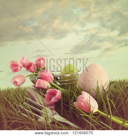 Fresh cut pink tulips with eggs in the tall grass