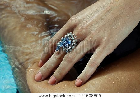 Hand with a Sapphire Ring