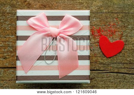 Gift box on wooden table