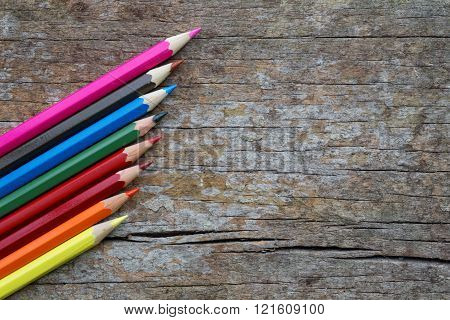 Colorful color pencils on wooden table