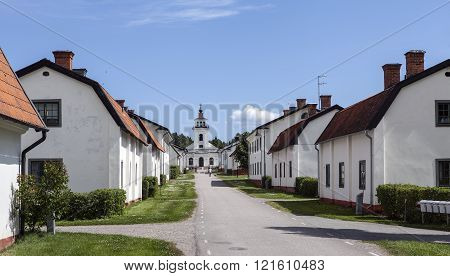 FORSMARK, SWEDEN ON JUNE 25. View of the Main Street up the church on June 25, 2013 in Forsmark, Sweden. Church in the end, unidentified people in the street. Editorial use.