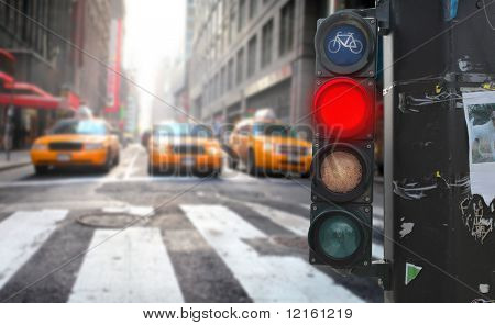 Traffic light with red light on a city street