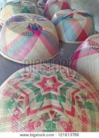 colorful handmade basketry of lids with pattern