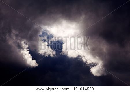Dark Sky With Small White Clouds