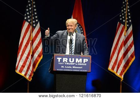 Saint Louis, MO, USA - March 11, 2016: Donald Trump shows the thumbs-up to supporters at the Peabody Opera House in Downtown Saint Louis.
