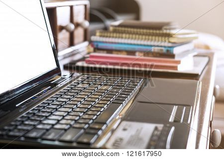 Close-up, soft focus keyboard with pile of book, selective focus, shallow depth of field