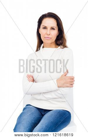 Unhappy woman staring at camera on white background