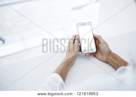 Female is searching information in network on cell telephone