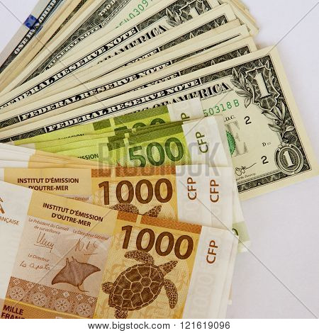 US Dollars and Polynesian Francs