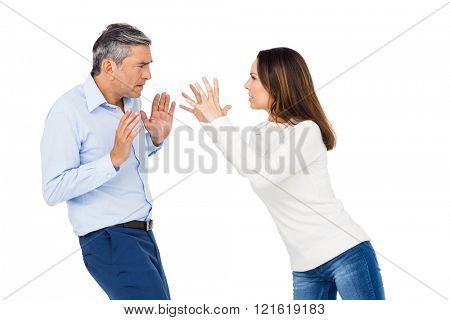 Annoyed woman yelling at husband against white background