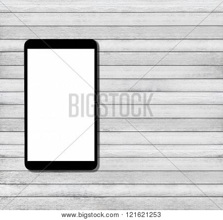 Tablet computer on wood texture background, with copy space