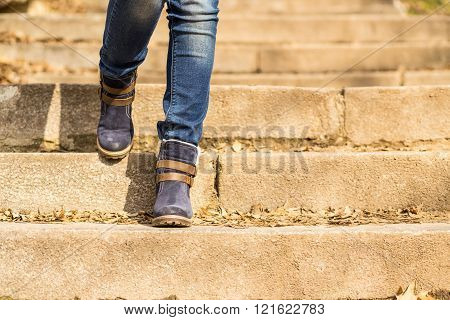 Womans Legs In Winter Boots Stepping Downstairs