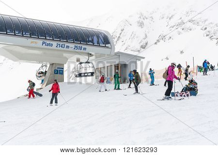 Bansko, Bulgaria - March 4, 2016: Bansko ski resort view, skiers on lift,  people skiing on slopes, mountains on background