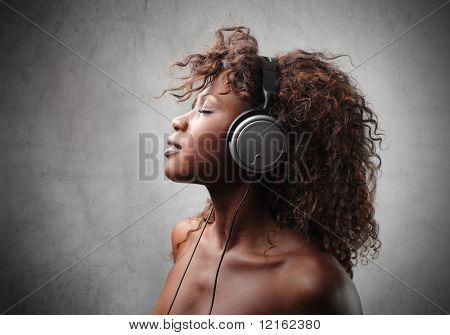 young black woman listen music