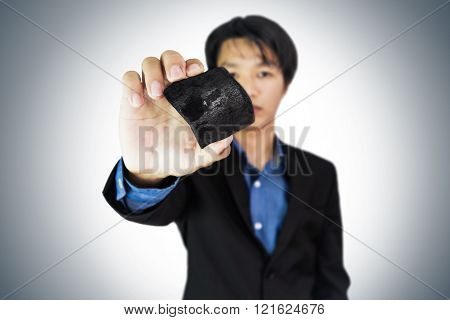 Business man showing coal,selective focus on coal