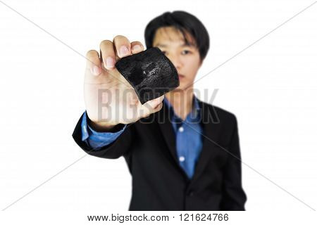 Businessman showing coal,selective focus on coal, isolated on white background