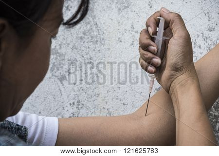 Drug Addict With Syringe In Action