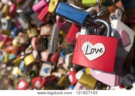 Love sign and romance concept. Heart shaped, love padlocks locked at landmark, tourists place