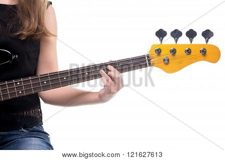 Woman's fingers on bass guitar