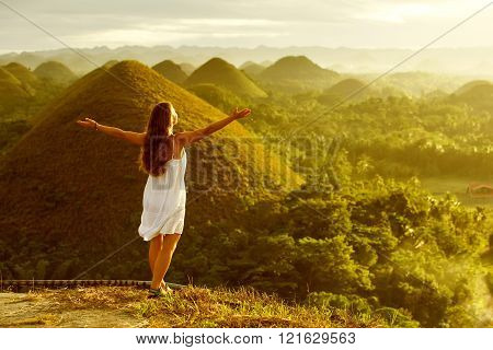woman doing yoga in The Chocolate Hills. Bohol Philippines
