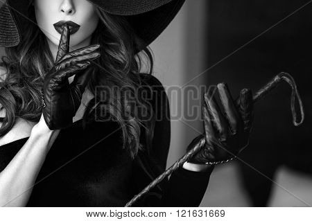Sexy Dominant Woman In Hat And Whip Showing No Talk