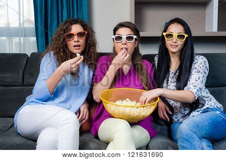 Girls watching a movie.