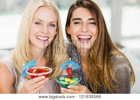 Portrait of beautiful women smiling and having mocktail
