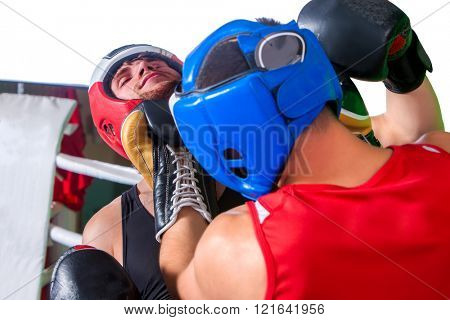 Two  men boxer wearing helmet and  gloves boxing in training . Aggressive boxers.