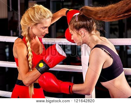Two  women boxer wearing red  gloves to box in ring. Boxing sport.