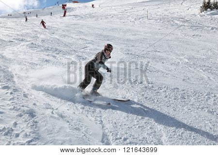 Woman skiing in ski resort in Austria - Bad Gastein in High Tauern (Hohe Tauern) mountain range in Alps.