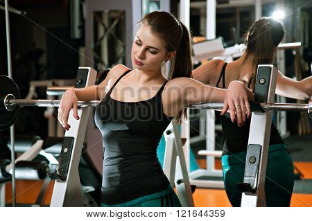 Fitness Girl Relaxing In The Gym